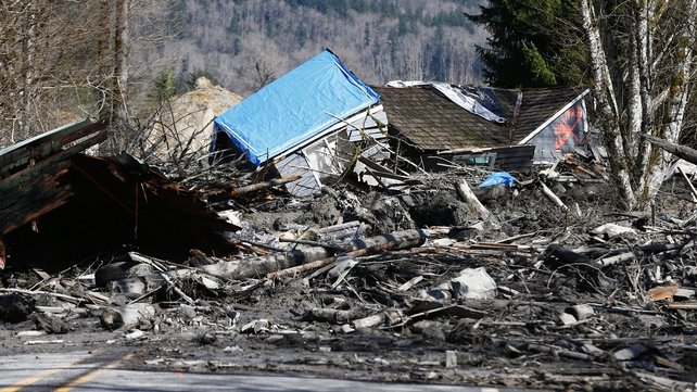 A house sits destroyed in the mud on Highway 530 near Arlington, Washington