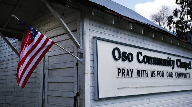 The Oso Community Church displays a sign reading 'pray with us for our community'