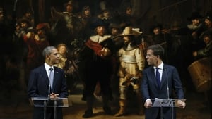 US President Barack Obama and Dutch Prime Minister Mark Rutte speak in front of Rembrandt's famous painting 'The Night Watch' as they visit the Rijksmuseum in Amsterdam (Pic: EPA)