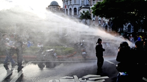 Riot police use water cannon to disperse protesters from the Cabinet compound in Taipei, Taiwan (Pic: EPA)