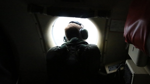 Aircrew look out of a window of a Royal Australian Air Force AP-3C Orion in the search for the missing Malaysian Airlines flight MH370