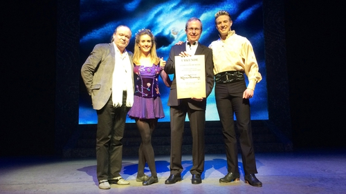 (l-r) Riverdance's promoter in Germany, Hermjo Klein; lead dancer Chloey Turner, winner Andreas Eschemann and lead dancer James Greenan