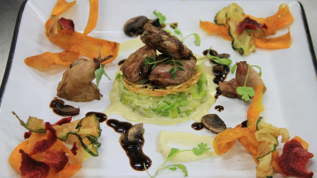 Pan fried quail with creamed leeks and parsnip puree with crispy vegetables, potato rosti and a por