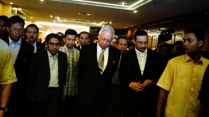 Malaysia's Prime Minister Najib Razak leaves after a news conference to announce that new data has concluded that flight MH370's final position was in the southern Indian Ocean