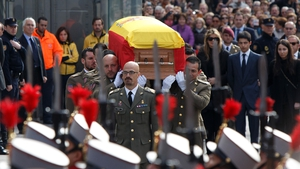 Soldiers carry the coffin of former Spanish prime minister Adolfo Suarez