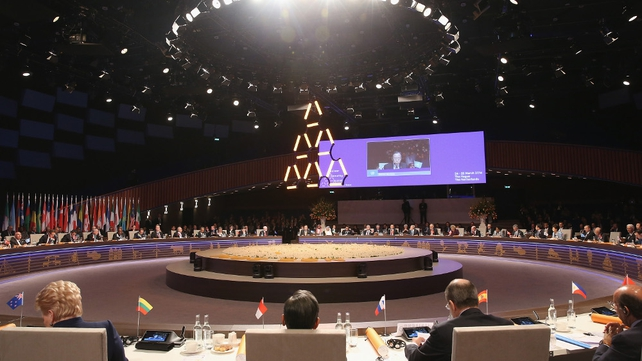 Delegates attend the opening plenary session of the 2014 Nuclear Security Summit in The Hague