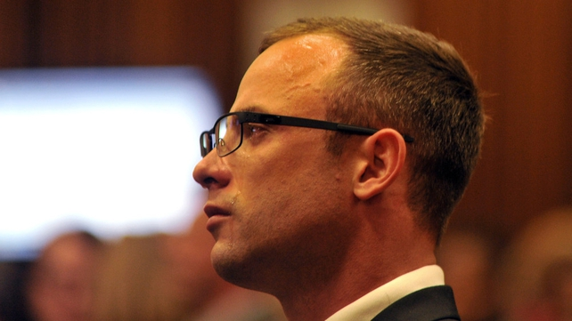 Oscar Pistorius cries as he sits in the dock