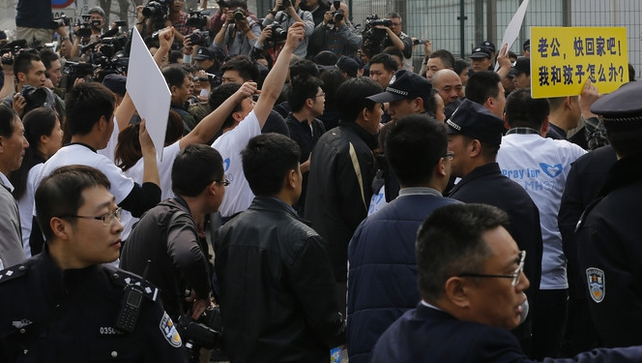 About 20 to 30 protesters threw water bottles at the Malaysian embassy in Beijing