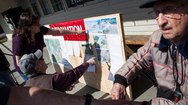 Residents read information about the mudslide