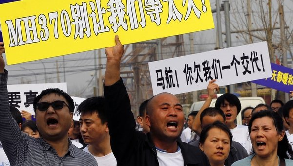 Relatives express their anger outside Malaysia's embassy in Beijing