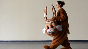 An actress wears an Easter bunny costume on her way to a press conference for the public trade fair Dresden Easter in Dresden, Germany (Pic: EPA)