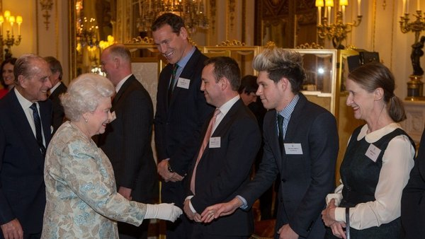 Niall Horan of One Direction meets Queen Elizabeth at Buckingham Palace