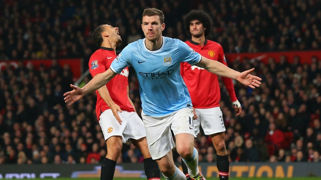 Edin Dzeko celebrates scoring Manchester City's second goal