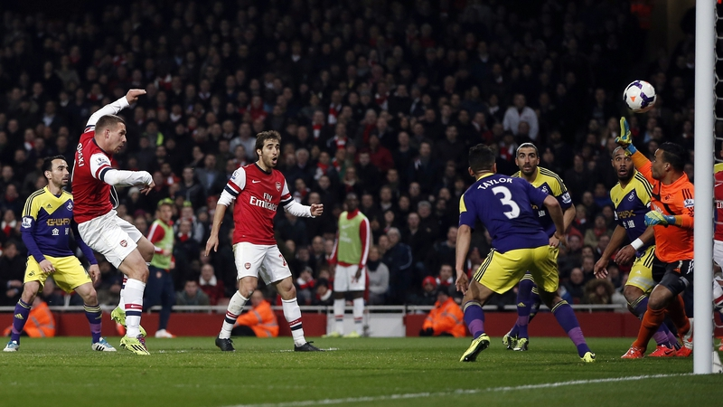 Lukas Podolski guides home Arsenal's opening goal