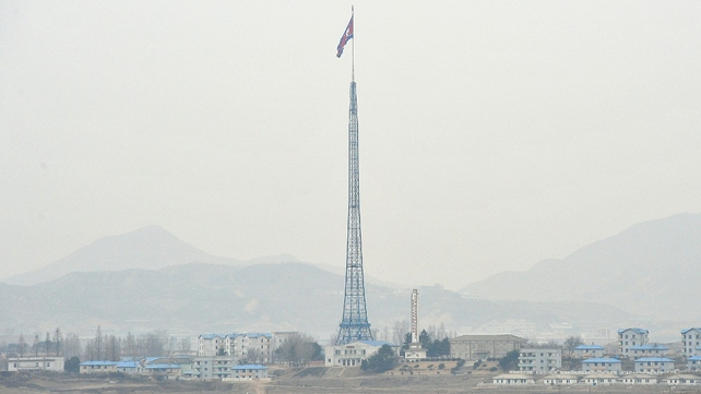 A North Korean flag flutters in the propaganda village of Gijungdong