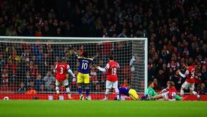 Swansea's Wilfried Bony celebrates as Mathieu Flamini of Arsenal scores an own goal to make it 2-2