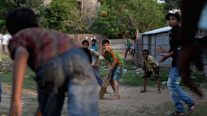 Local children play cricket in the street in Chittagong, Bangladesh, one of the venues of the T20 World Cup