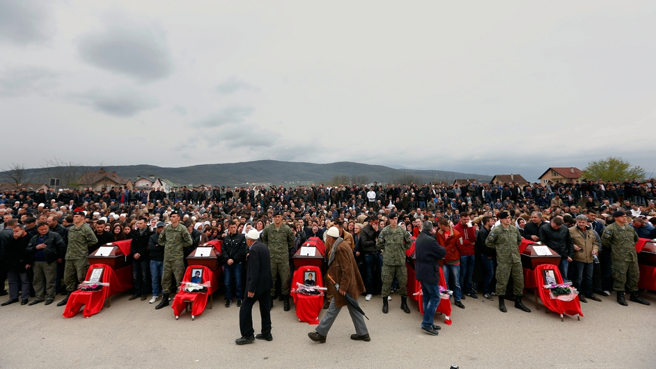 Albanians mourn during a reburial ceremony for victims of the 1998-99 war, in the village of Krusha e Vogel, Kosovo (Pic: EPA)