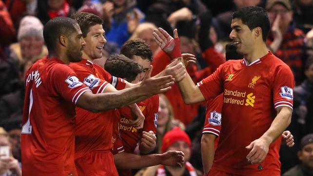 Steven Gerrard (centre) celebrates scoring Liverpool's opening goal