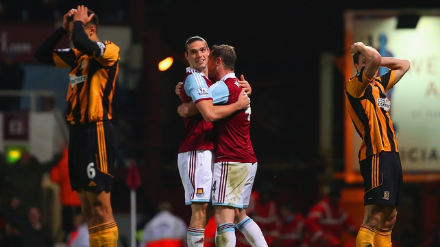 West Ham's Andy Carroll and Kevin Nolan celebrate after James Chester's own goal for West Ham