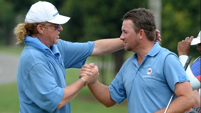 Miguel Angel Jimenez congratulates Graeme McDowell after his win