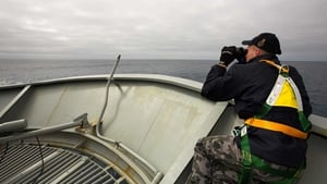 Able Seaman Kurt Jackson keeps watch on the forecastle of the Royal Australian Navy ship HMAS Success during the search for the plane (Pic: EPA)