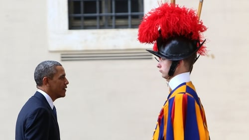 US President Barack Obama encounters a Swiss Guard during his visit to the Vatican