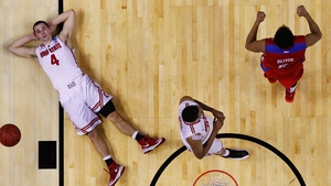 Aaron Craft (l) of the Ohio State Buckeyes reacts after losing to the Dayton Flyers in Buffalo, New York