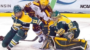 The Minnesota Golden Gophers and the Clarkson Golden Knights contest the puck during the Women's Ice Hockey Championship in Connecticut