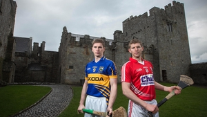 Hurlers Brendan Maher of Tipperary and Cork's Lorcan McLoughlin pose at a photoshoot at Cahir Castle ahead of the Allianz Hurling League quarter-final tie