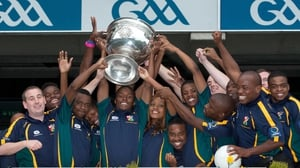 South African Gaels players in Croke Park with the Sam Maguire trophy