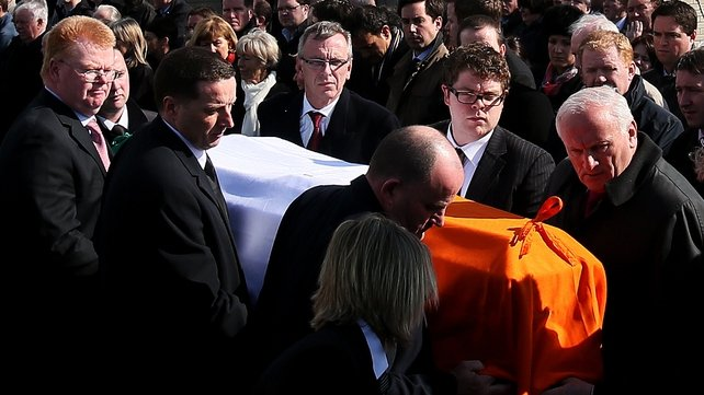 The coffin is carried by pall bearers including Ms Fadden's son son Eoin (2nd right)
