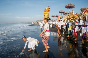 Balinese Hindu devotees carry 'Pratima' or a symbol of God during a cleansing ceremony called 'Melasti' at a beach in Gianyar, Bali (Pic: EPA)