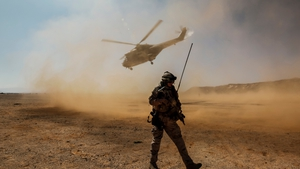 A helicopter takes off after dropping off passengers at the Bosaso airport, in Somalia's semi-autonomous state Puntland