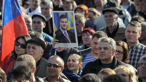 A pro-Russian protester holds a portrait of former Ukrainian president Viktor Yanukovych during a rally in downtown Donetsk, Ukraine earlier this week (Pic: EPA)