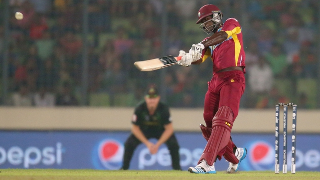 Darren Sammy of the West Indies hits a six in the final over