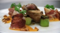 Rabbit legs braised in cider, bacon wrapped loin, carrot puree and leeks - Mark McGrath's National Dish recipe.