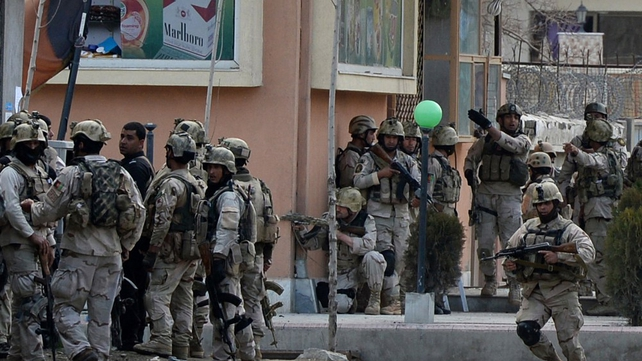 Afghan members of a special reaction team are deployed at the scene of the attack