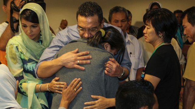 Malaysia's acting Transport Minister Hishamuddin Hussin hugs a family member of a missing passenger (Pic: EPA)