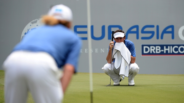 Gonzalo Fernandez-Castano lines up his putt on the 18th green