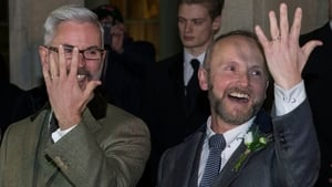 Neil Allard (R) and Andrew Wale show off their rings following their marriage. They were one of the first same-sex weddings in England overnight