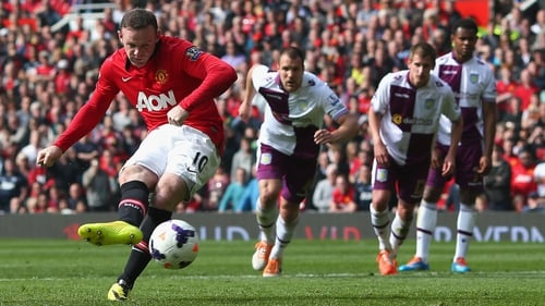 Wayne Rooney scores a penalty, his second goal for Manchester United