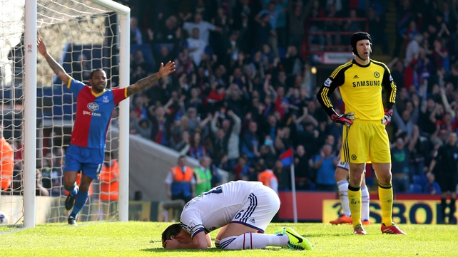 A dejected John Terry (c) reacts after scoring an own goal to give Palace the lead