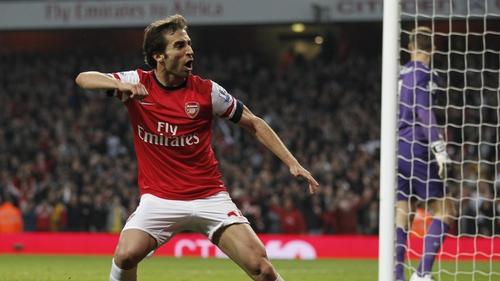 Arsenal's Mathieu Flamini celebrates scoring the equaliser
