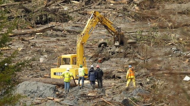 Crews work at the Oso mudslide site in Washington