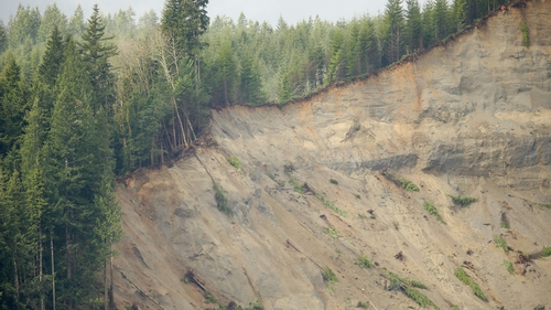 The remnants of a hill where a massive mudslide took place