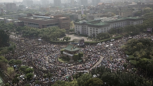 Thousands of protesters attend a rally in Taiwan to protest over a trade agreement with China