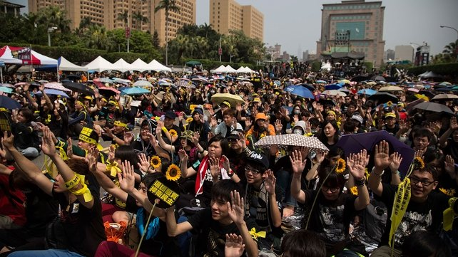 Tens of thousands are protesting over a controversial trade pact with China