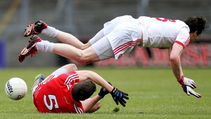 Tomas Clancy and Colm Cavanagh collide in the thrilling Cork-Tyrone encounter