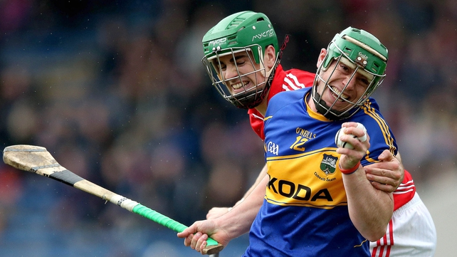 John O'Dwyer and William Egan battle for the sliotar